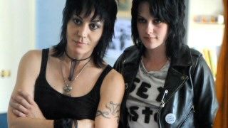"The real Joan Jett stands next to Kristen Stewart portraying her in this photo from ""Plugged In: Making the Film."""