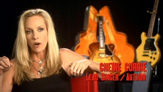 At age 50, Cherie Currie reveals she's still a bit of a sex kitten in her featurette interviews.