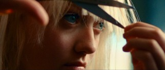 Fifteen-year-old Cherie Currie (Dakota Fanning) gives her bangs an uneven trim for a talent show makeover.