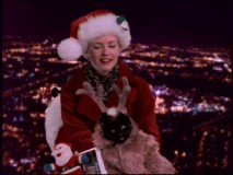 "Sabrina fills in for Jolly Old St. Nick (played by John Ratzenberger) in the Christmas episode ""Sabrina Claus."""