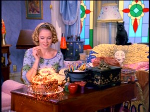 Sabrina the Teenage Witch (Melissa Joan Hart) lives up to her name by using her spirited pointer finger to conjure up a dessert.