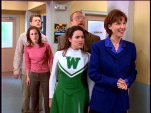 "Harvey (Nate Richert), Valerie (Lindsay Sloane), Libby (Jenna Leigh Green), Mr. Kraft (Martin Mull), and Mrs. Quick (Mary Gross) have a variety of surprised reactions to seeing alternate versions of themselves in the episode ""Sabrina, The Teenage Writer."""