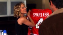 "Samantha admires her new customized Blackhawks jersey in ""The Hockey Date."""