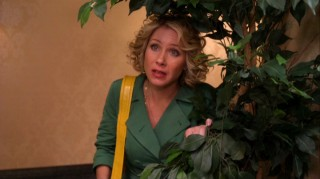 No, Nancy Drew hasn't grown up. That's just Samantha Who, hiding behind a plant to be Todd's affair.