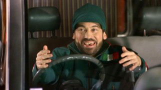 Eli the Elf (Danny Woodburn) is able to summon ethnic caricatures with speed, a skill that apparently qualifies him to be Santa's global mailman. Here, he shows us his Italian.