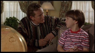 Psychiatrist Neil (Judge Reinhold) is not pleased to hear Charlie's firm belief in Santa Claus.