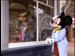 While cleaning a shop window to get Main Street, U.S.A. ready for the park's opening, Mickey recognizes a familiar face.