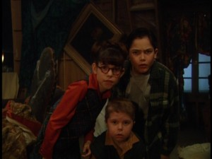"Clockwise from left: The three children at the core of ""Sing Along Songs: Happy Haunting"": Sally (Rachel Ham), Zach (a young Tyler Hoechlin), and special little Sam (Isaiah Griffin)."