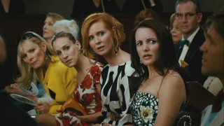 Samantha (Kim Cattrall), Carrie (Sarah Jessica Parker), Miranda (Cynthia Nixon), and Charlotte (Kristin Davis) are none too pleased when someone tries outbidding them at an auction.