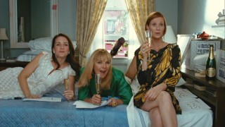 Charlotte (Kristin Davis), Samantha (Kim Cattrall), and Miranda (Cynthia Nixon) critique the wardrobe Carrie plans on bringing to her new apartment.