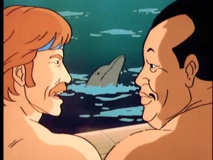 "Chuck Norris and his equally shirtless friend, Blasian samurai Tabe, speak in profile, while a dolphin swims between them in ""Deadly Dolphin."""