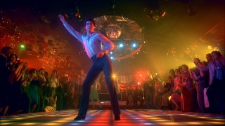 To applause, disco music, and all sorts of colored lights, Tony shows why he's king of the 2001 Odyssey dance floor.