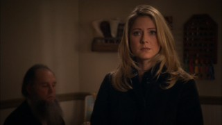 Sarah Cain (Lisa Pepper) is a stranger at her estranged sister's funeral, as evidenced by the man in the background's bushy beard.