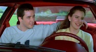 Lloyd (John Cusack) teaches Diane (Ione Skye) how to drive a stick shift, with both enjoying the experience far more than your typical behind-the-wheel lesson.
