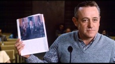 James Court (John Mahoney) holds up a picture of Ronald Reagan to make a point for the town board in this deleted scene.