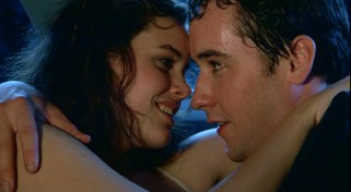 "Diane (Ione Skye) and Lloyd (John Cusack) cuddle to the sound of Peter Gabriel's ""In Your Eyes."""