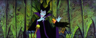 Maleficent sits wickedly while chatting with her pet raven Diablo.