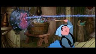 Merryweather does an over-the-shoulders, off-the-pot move to make Flora's dress her beloved blue. Believe it or not, fussing over colors is the act with dire consequences. Cap from 2003 Special Edition - click to view in 720 x 480.