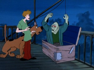 Shaggy and Scooby-Doo get spooked by a zombie, one of a deserted town's two feared residents in the disc's first episode.