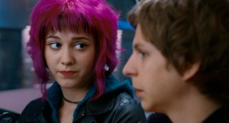 On a shared bus ride, magenta-haired Ramona (Mary Elizabeth Winstead) explains Scott's predicament of having to fight and defeat her seven evil exes.