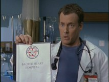 Dr. Cox likes to go off on tirades. Here, he's apparently consulting a hospital manual.