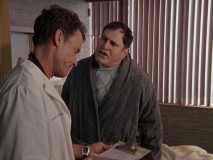"Dr. Cox butts heads with Harvey Corman (guest Richard Kind) over a full body scan in ""My Fault."""