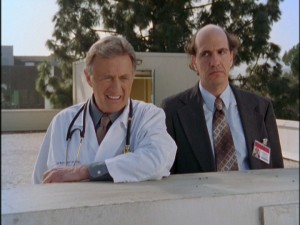 Sacred Heart's roof becomes an increasingly-seen location in Season 3. Here, Dr. Kelso (Ken Jenkins) shows little regard for the hospital's thankless lawyer Ted (Sam Lloyd).