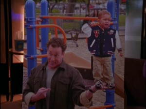 Dr. Cox's proud playground antics put him in a compromising position when this enlarged photograph gets sent to Jordan.
