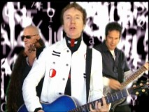"British pop rocker G Tom Mac appears (with two shady-looking companions) in the music video ""Half."""