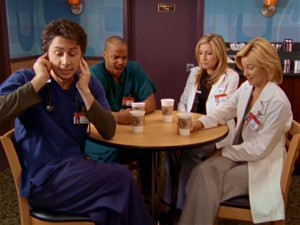 J.D. covers his ears during an outburst by Elliot (Sarah Chalke). They're joined by Turk and Kim (Elizabeth Banks) at Coffee Bucks, the hospital coffee shop introduced in Season 6.