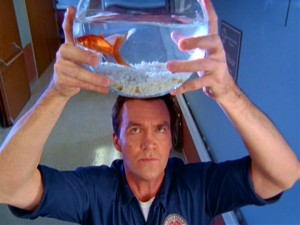 The Janitor wrestles with the responsibility of watching J.D.'s fishbowl.
