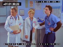 Dr. Kelso, Kim, and J.D. look towards disaster in a deleted scene involving Doug, a corpse, and an unstable floor/ceiling.