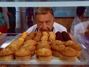 Dr. Kelso (Ken Jenkins) is perfectly pleased to win free muffins for life from Coffee Bucks.