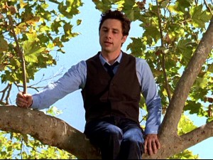 Perched in a tree for an outdoor class, J.D. (Zach Braff) peppers his lesson with botanical puns.