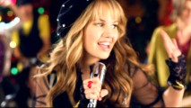 "Nothing says ""Deck the Halls"" like the sight of Debby Ryan in fingerless black lace gloves like 1980s Madonna."