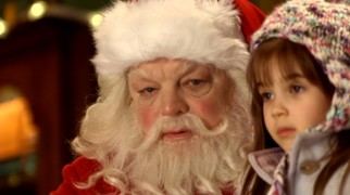 Hucklebuckle's in-store Santa (Richard Riehle) doesn't know who he is, but Quinn (Kaitlyn Maher) is too adorable to care.