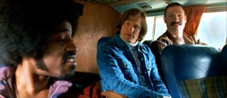 Tensions exist between the Tropics' two star players, Downtown Funky Stuff Malone (André Benjamin) and Ed Monix (Woody Harrelson), seen here on the team bus.