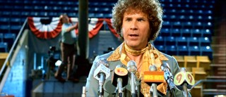 Jackie Moon rocks the neckerchief at the press conference in which he announces the Tropics' Mega Bowl.