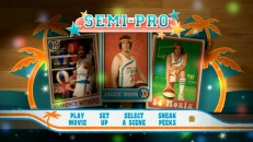 Disc 1's colorful main menu shuffles through trading cards of players and related Tropics employees.