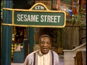 A Jell-O pudding pop in each hand wouldn't make Bill Cosby any happier to host this 20th anniversary Sesame Street special.