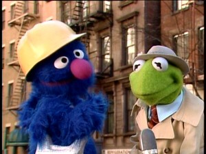 Kermit the Frog wants construction worker Grover to tell him how to get, how to get to Sesame Street.