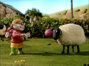 The farmer's reckless niece amuses herself by throwing a ball at a sheep's face.