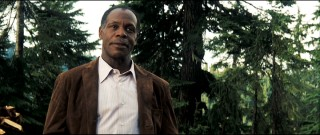 Colonel Isaac Johnson (Danny Glover) has a slight lisp and a deceptive warmth.