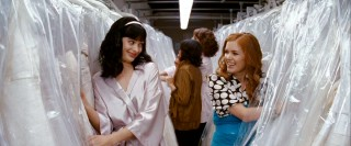 Of course best friends Suze (Krysten Ritter) and Becky (Isla Fisher) are going to be giddy whilst shopping for a wedding dress. Would you expect anything else from ditzy chick flick chicks?