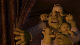 Shrek has his hands and most of the rest of his body full with baby ogres. Don't worry; it's just a nightmare sequence.
