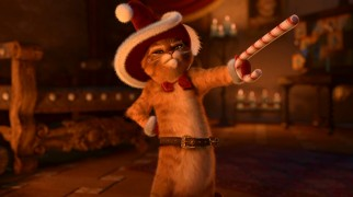 Puss in Boots describes his version of Santa Claus (Claws), who wields a candy cane sword and bears a striking resemblance to Puss.