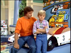 "At the center of ""Silver Spoons"" is newly united father-son pair of goofy millionaire Edward Stratton (Joel Higgins) and smart-aleck 12-year-old Ricky Stratton (Ricky Schroder)."