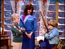 "Ricky and Kate are happy to give ""The Best Christmas Ever"" to cave boy Joey Thompson (Joey Lawrence)."