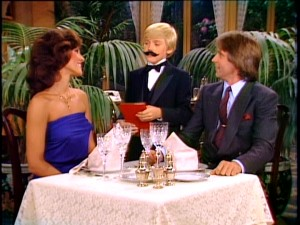 If Kate and Edward don't seem too surprised to find a mustachioed Ricky is their waiter, that's because they're dining in their living room.