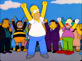 Homer and his fellow plump citizens celebrate Springfield's entry into the record books as the world's fattest town.